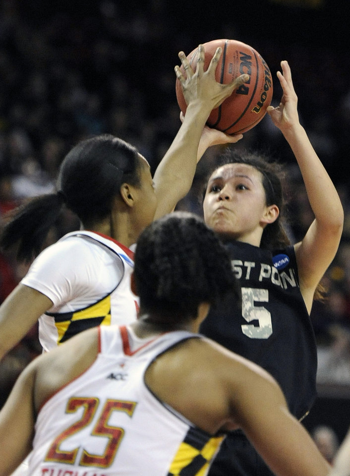 Photo - Army's Kelsey Minato (5) shoots over Maryland's Shatori Walker-KImbrough during the first half of the first round of the NCAA women's college basketball tournament on Sunday, March 23, 2014, in College Park, Md. Maryland won 90-52. (AP Photo/Gail Burton)
