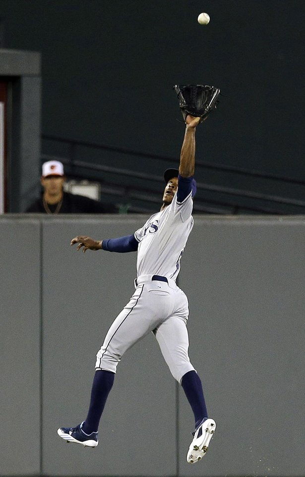 Photo -   Tampa Bay Rays center fielder B.J. Upton leaps to catch a fly ball by Baltimore Orioles' Adam Jones in the first inning of a baseball game in Baltimore, Wednesday, Sept. 12, 2012. (AP Photo/Patrick Semansky)
