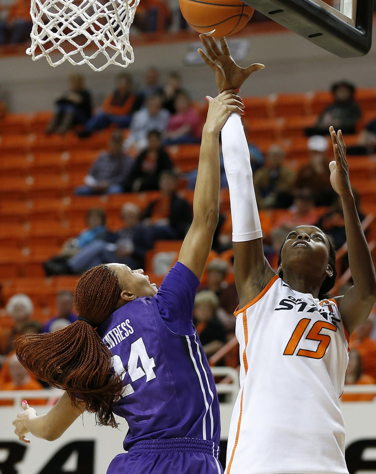 Oklahoma State's Toni Young (15) scores a basket over TCU's Natalie Ventress (24) during a women's college basketball game between Oklahoma State University and TCU at Gallagher-Iba Arena in Stillwater, Okla., Tuesday, Feb. 5, 2013. Oklahoma State won 76-59.  Photo by Bryan Terry, The Oklahoman