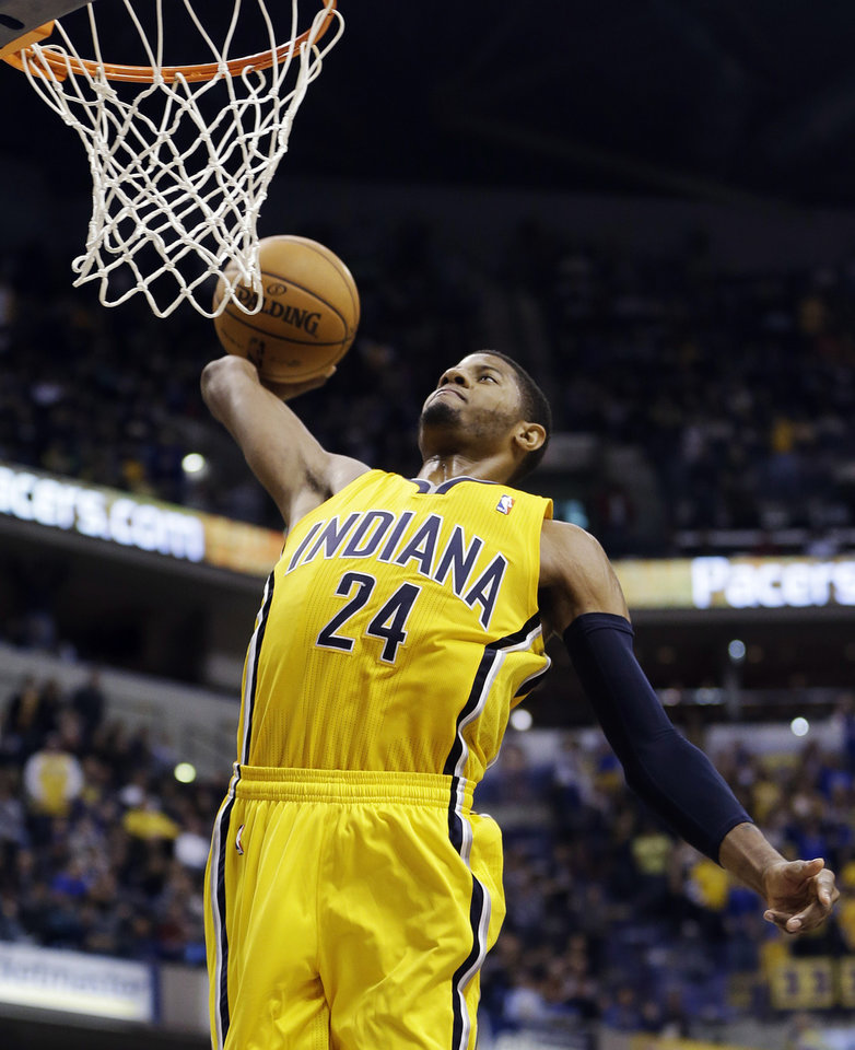 Indiana Pacers' Paul George goes in for a dunk during the second half of an NBA basketball game against the Memphis Grizzlies, Monday, Dec. 31, 2012, in Indianapolis. Indiana won 88-83. (AP Photo/Darron Cummings)