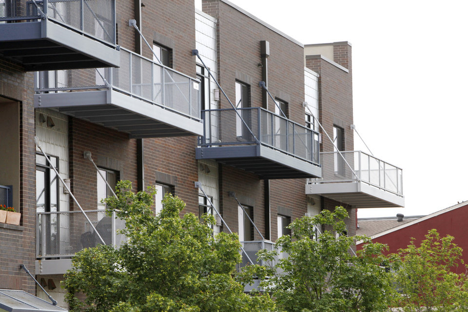Photo - A proposed new Oklahoma City ordinance would mean downtown residents could only put items designed for outdoor use on areas of their balconies visible from a public street. The balconies shown here are on an apartment complex downtown. Photos by Paul Hellstern, The Oklahoman