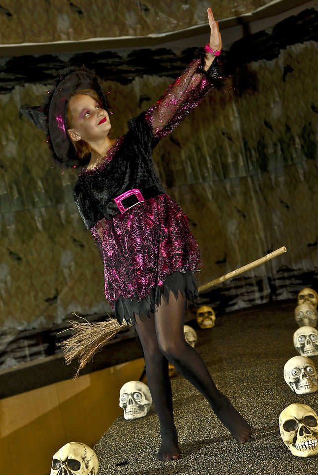 Darling Witch costume modeled by Ella. Photo by Chris Landsberger, The Oklahoman. <strong>CHRIS LANDSBERGER</strong>