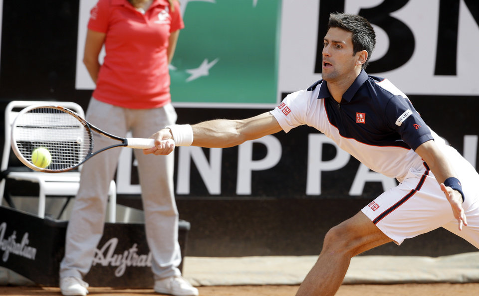 Photo - Serbia's Novak Djokovic returns the ball to Spain's Rafael Nadal during their final match at the Italian Open tennis tournament, in Rome, Sunday, May 18, 2014. (AP Photo/Andrew Medichini)
