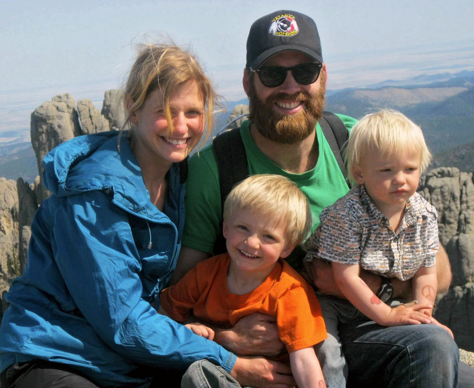 This May 13, 2012, family photo provided by Nathan Ochs shows his wife, Constance Van Kley, Nathan Ochs and their sons Rudy, left, and Abraham during a visit to Little Devils Tower near Custer, S.D. If hotshot firefighter Nathan Ochs is hurt on the job, workers compensation would pay for his medical care. When his son Rudy was born seven weeks premature, Ochs and his wife were left with a $70,000 hospital bill because they had no health insurance. Thousands of wildland firefighters aren't eligible for federal health insurance so they have launched an online petition to change that_ drawing more than 90,000 signatures in a matter of days. (AP Photo/Ochs Family) ORG XMIT: CODE102 <strong>Uncredited - AP</strong>