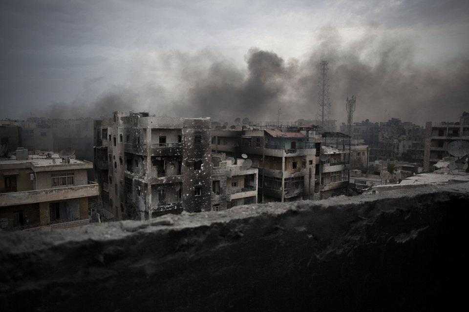 Smoke rises over Saif Al Dawla district in Aleppo, Syria, Tuesday, Oct. 2, 2012. The U.N.\'s deputy secretary-general says U.N. chief Ban Ki-moon made a strong appeal to Syria\'s foreign minister to stop using heavy weapons against civilians and reduce the violence that is killing 100 to 200 people every day.(AP Photo/ Manu Brabo)