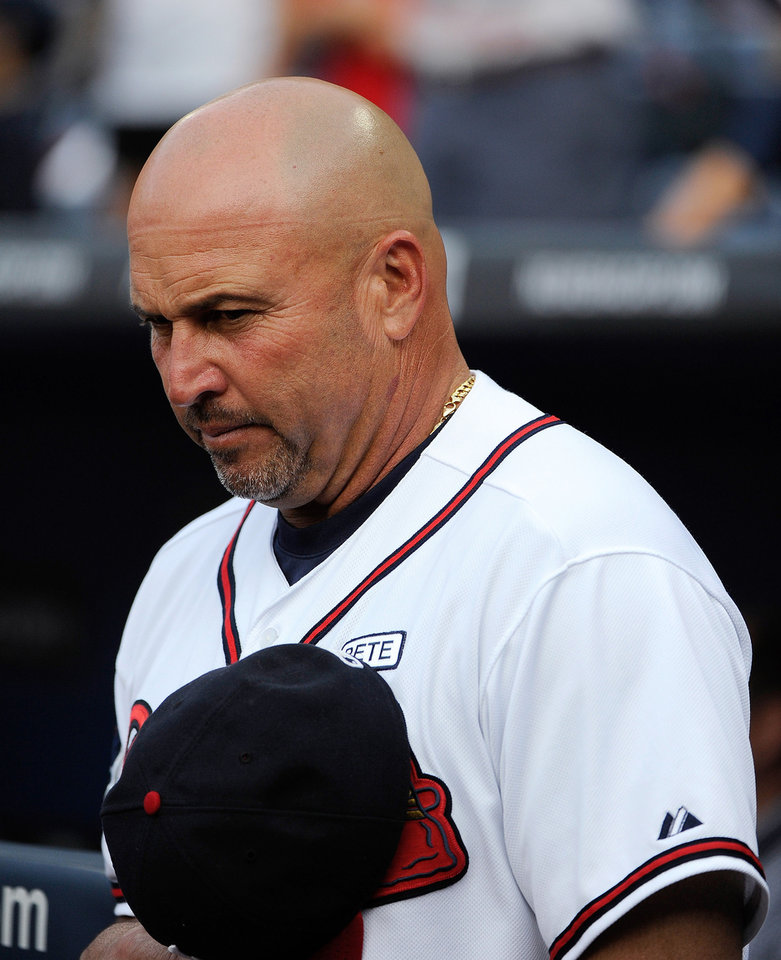 Photo - Atlanta Braves manager Fredi Gonzalez wears a patch on his left chest bearing the name