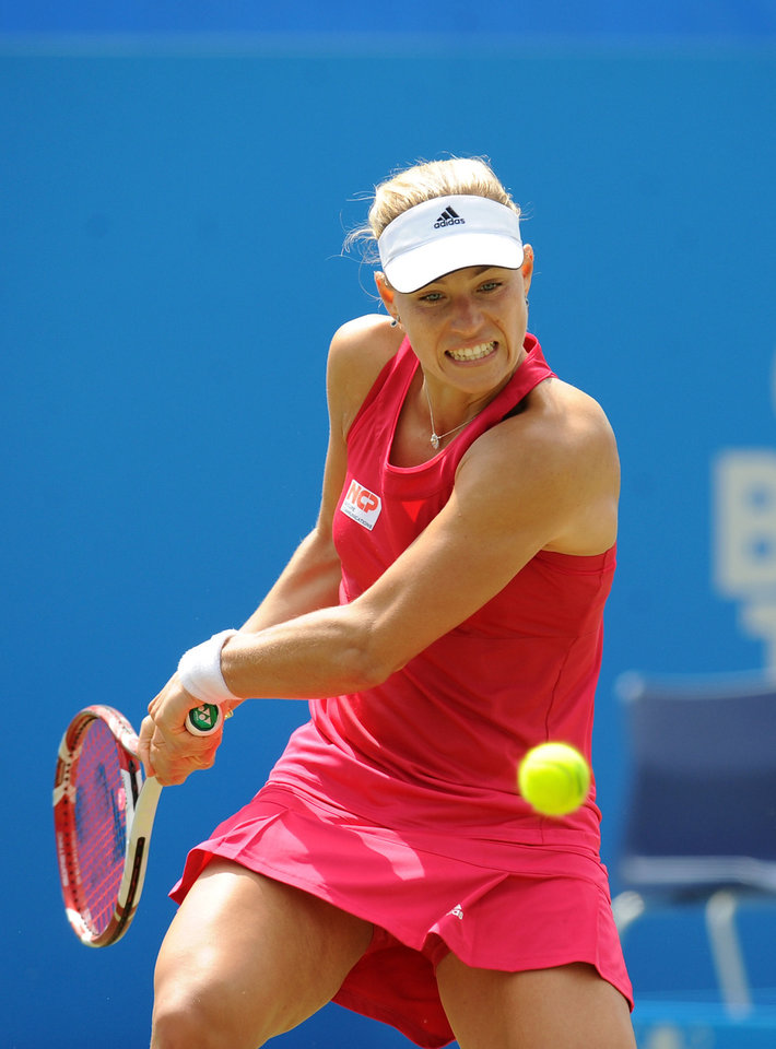 Photo - Germany's Angelique Kerber plays a return to Denmark's Caroline Wozniacki during their semifinal match at the Aegon International tennis tournament at Devonshire Park, Eastbourne, southern England, Friday June 20, 2014. (AP Photo/PA, Clive Gee) UNITED KINGDOM OUT  NO SALES  NO ARCHIVE