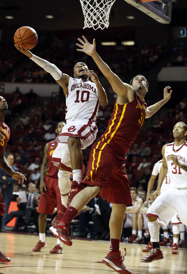 Photo - Oklahoma Sooner's Jordan Woodard (10) shoots over Iowa State Cyclone's Georges Niang (31) as the University of Oklahoma Sooners (OU) men defeat the Iowa State Cyclones (ISU) 87-82 in NCAA, college basketball at The Lloyd Noble Center on Saturday, Jan. 11, 2014  in Norman, Okla. Photo by Steve Sisney, The Oklahoman