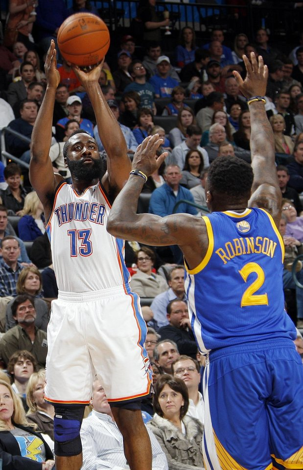 Photo - Oklahoma City's James Harden (13) shoots over Nate Robinson (2) of Golden State during the NBA basketball game between the Oklahoma City Thunder and the Golden State Warriors at the Chesapeake Energy Arena in Oklahoma City, Friday, Feb. 17, 2012. Photo by Nate Billings, The Oklahoman