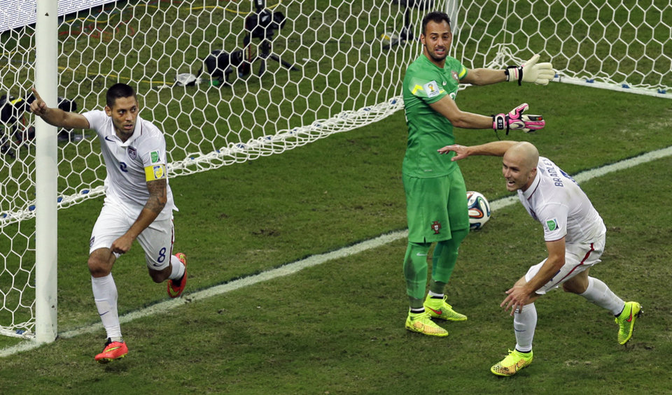 Photo - United States' Clint Dempsey, left, celebrates scoring his side's second goal during the group G World Cup soccer match between the USA and Portugal at the Arena da Amazonia in Manaus, Brazil, Sunday, June 22, 2014. (AP Photo/Themba Hadebe)