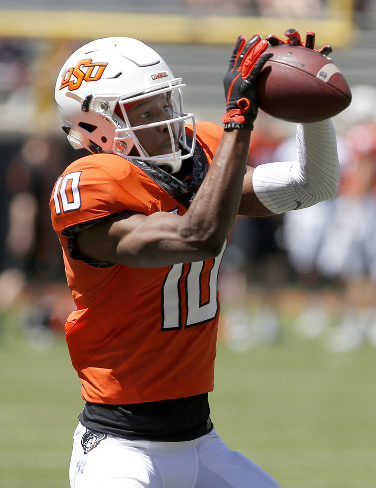Photo - Oklahoma State's Tyrell Alexander (10) makes a catch during drills during the Oklahoma State Cowboys spring practice at Boone Pickens Stadium in Stillwater, Okla., Saturday, April 20, 2019.  Photo by Sarah Phipps, The Oklahoman