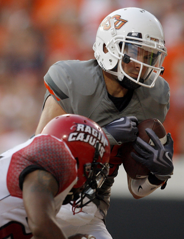 Photo - Oklahoma State's Josh Cooper catches a touchdown in front of Louisiana-Lafayette's Lionel Stokes on Saturday in Stillwater. Photo by Sarah Phipps, The Oklahoman