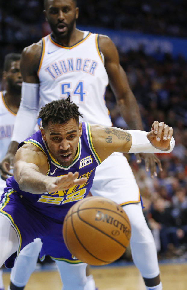 Photo - Utah's Thabo Sefolosha (22) loses the ball in front of Oklahoma City's Patrick Patterson (54) during an NBA basketball game between the Utah Jazz and the Oklahoma City Thunder at Chesapeake Energy Arena in Oklahoma City, Monday, Dec. 10, 2018. Photo by Nate Billings, The Oklahoman