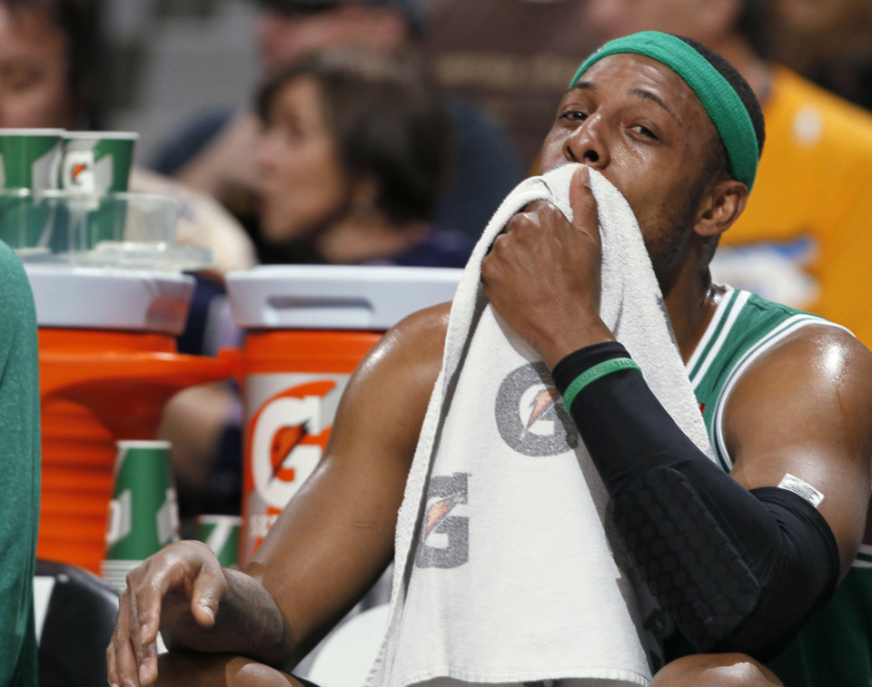 Photo - Boston Celtics forward Paul Pierce takes a seat on the bench during the first quarter of an NBA basketball game against the Denver Nuggets in Denver on Tuesday, Feb. 19, 2013. (AP Photo/David Zalubowski)