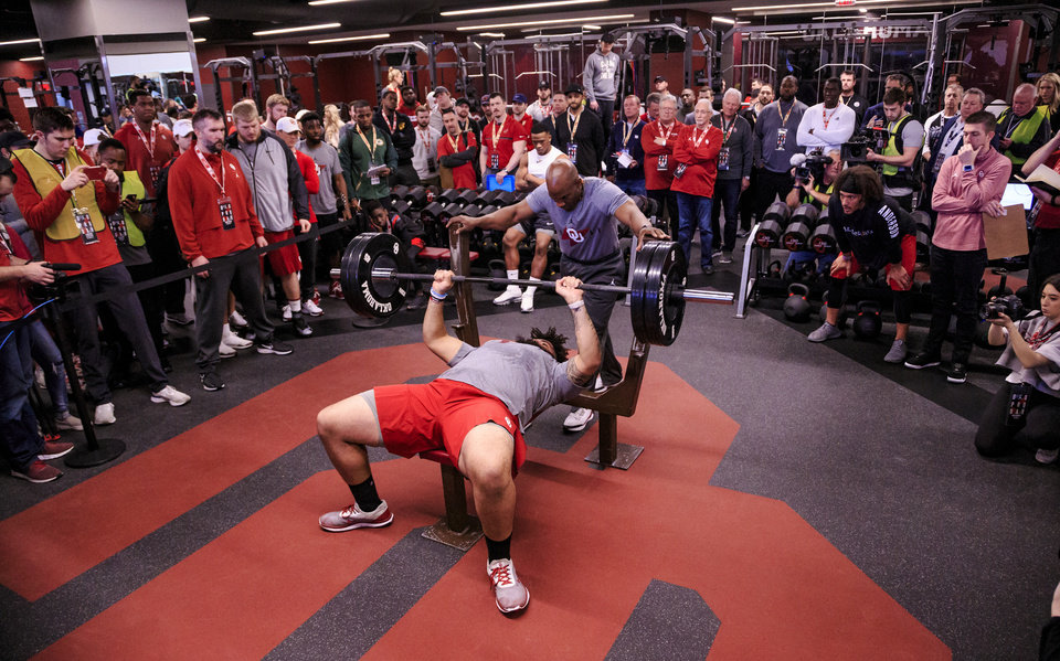 Photo - Cody Ford does the bench press as he works out for NFL scouts during the University of Oklahoma football pro day at the University of Oklahoma in Norman, Okla. on Wednesday, March 13, 2019.   Photo by Chris Landsberger, The Oklahoman