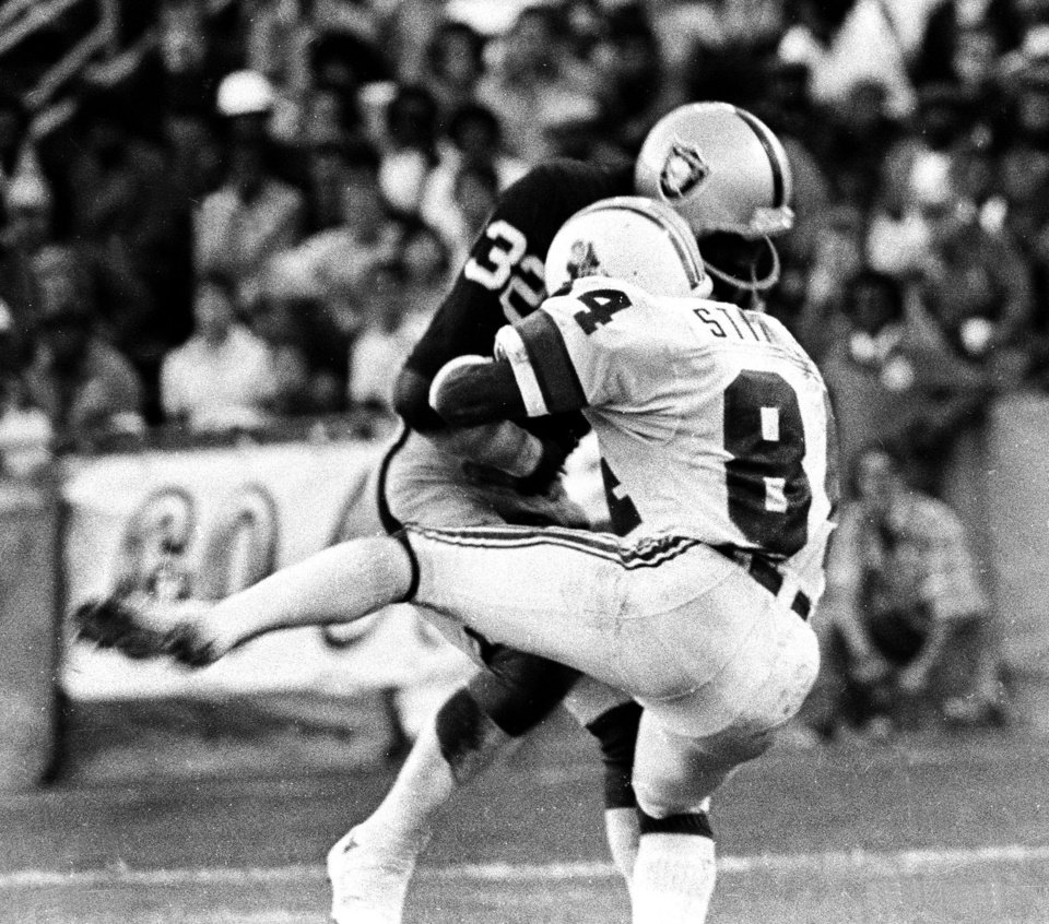 FILE - This Aug. 12, 1978 file photo shows Oakland Raider\'s Jack Tatum (32) hitting New England Patriots receiver Darryl Stingley (84) during an NFL preseason football game in Oakland, Calif. Violence is part of the game in many sports. But when athletes cross the line it can attract the attention of authorities _ sometimes from within their sport and in other cases from criminal prosecutors. The punishment of four members of the New Orleans Saints for participating a cash-for-hits bounty system targeting opponents is the latest example but not the only one. (AP Photo/Oakland Tribune, Ron Riesterer, File) NO SALES