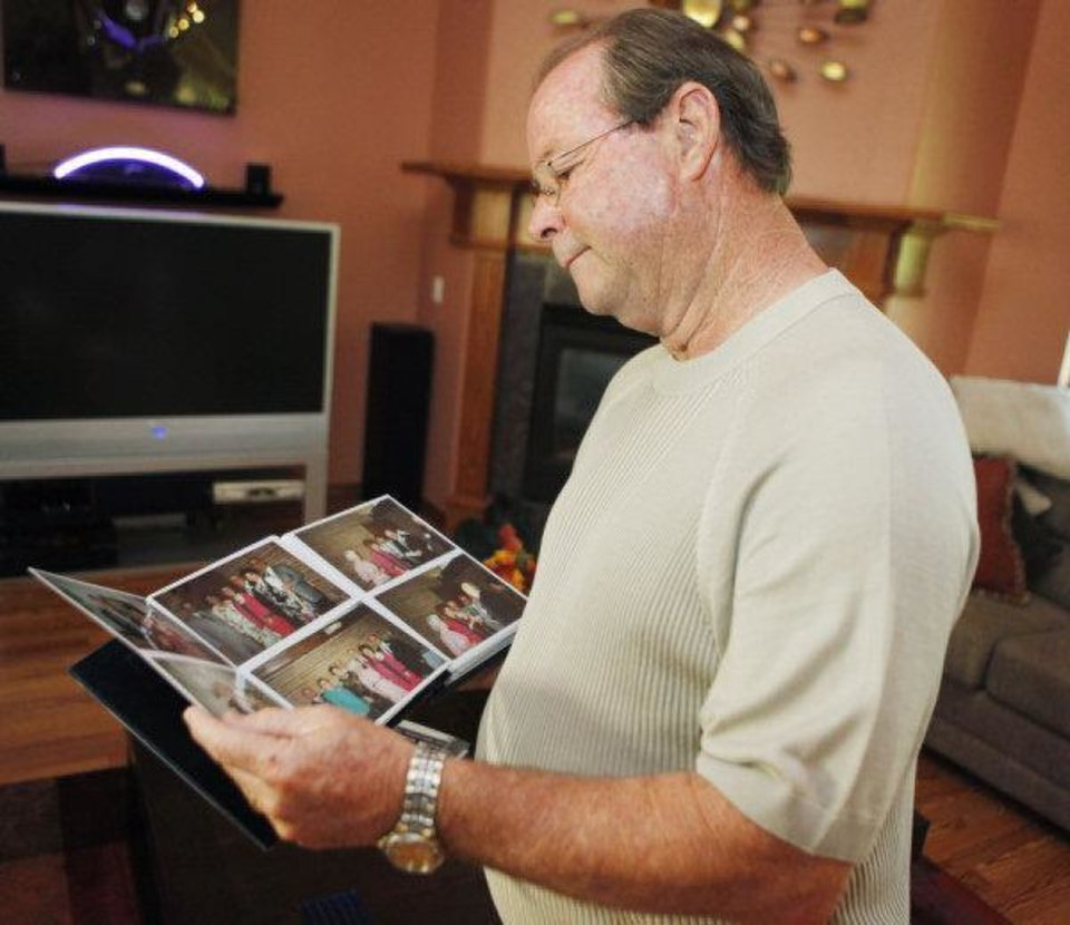 Terry Haynes looks through a photo album from the 50th wedding anniversary of his parents, Doris and Boyd Haynes, at his home in Oklahoma City, Thursday, July 14, 2011. Cherokee Ballard, spokeswoman for the Oklahoma medical examiner, said the deaths of Boyd Haynes, 87, and Doris Haynes, 86, have been ruled homicides. The couple was couple found dead after their house was firebombed Wednesday. Photo by Nate Billings, The Oklahoman ORG XMIT: KOD