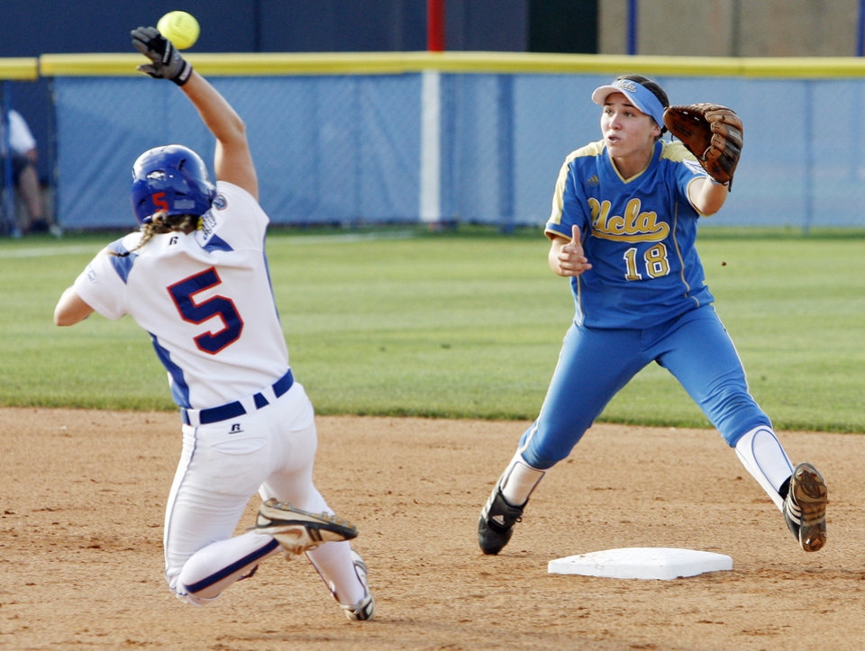 Photo - UNIVERSITY OF CALIFORNIA, LOS ANGELES, UNIVERSITIY OF FLORIDA, COLLEGE SOFTBALL: Florida's Kim Waleszonia (5) slides as she steals second base as UCLA's Monica Harrison (18) waits for the ball in the first inning during the softball game in the Women's College World Series between UCLA and Florida at ASA Hall of Fame Stadium in Oklahoma City, Saturday, May 31, 2008. BY NATE BILLINGS, THE OKLAHOMAN ORG XMIT: KOD