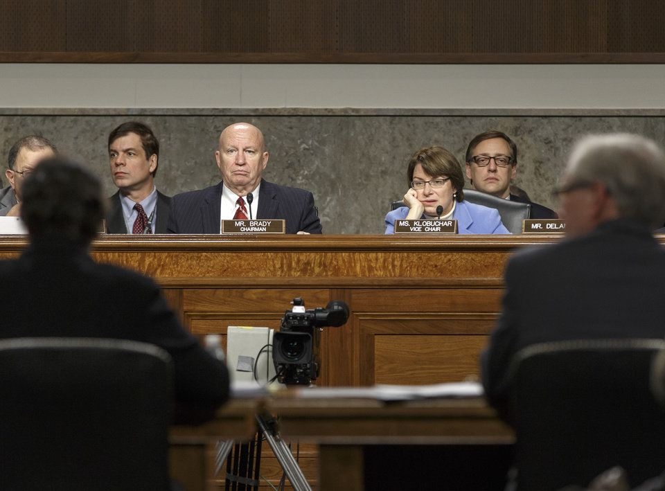 Photo - Rep. Kevin Brady, R-Texas, left, the Joint Economic Committee chairman, and Sen. Amy Klobuchar, D-Minn., the vice-chair, hold a hearing to examine the employment situation for December 2013, on Capitol Hill in Washington, Friday, Jan. 10, 2014.  (AP Photo/J. Scott Applewhite)