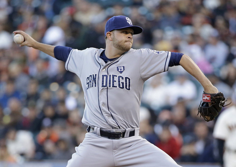 Photo - San Diego Padres starting pitcher Jesse Hahn throws against the San Francisco Giants in the first inning of their baseball game Tuesday, June 24, 2014, in San Francisco. (AP Photo/Eric Risberg)