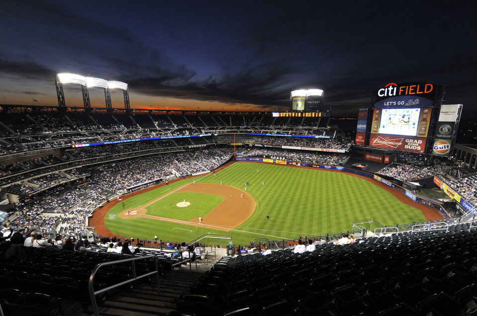Photo - The sun sets over Citi Field in the fourth inning of a baseball game between at the New York Mets and the Philadelphia Phillies, Friday, Aug. 29, 2014, in New York. (AP Photo/Kathy Kmonicek)