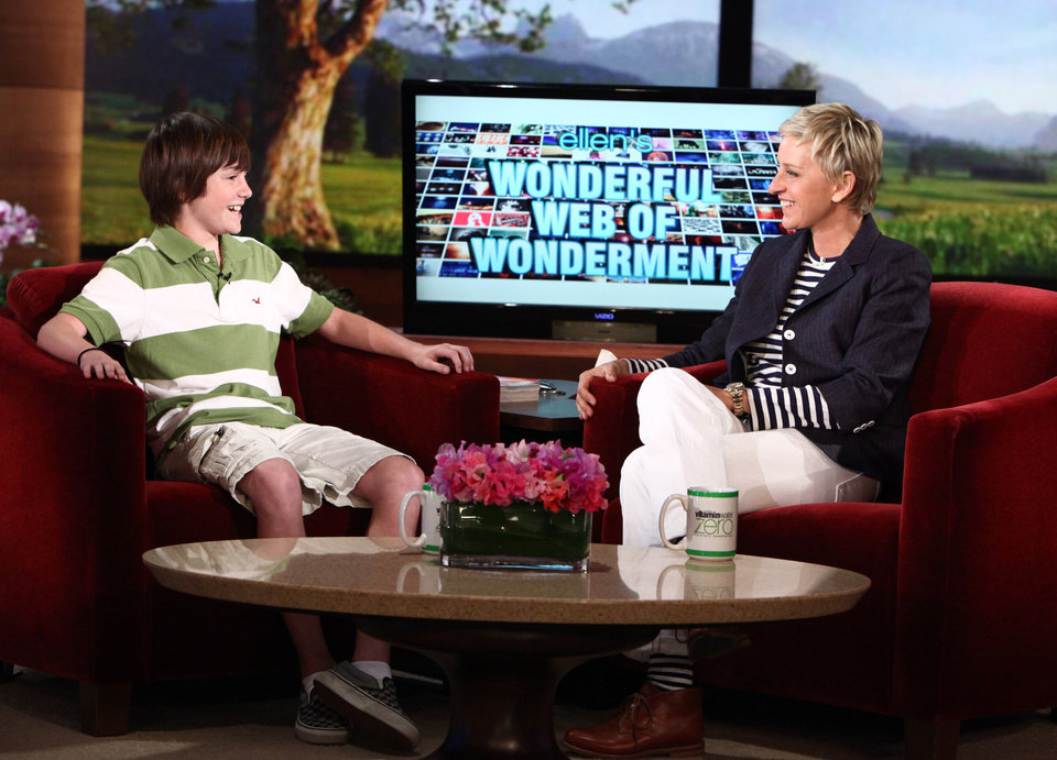 "Photo - In this photo released by Warner Bros., talk show host Ellen DeGeneres welcomes YouTube sensation Greyson Chance from Edmond. Making his television debut, Greyson performs ""Paparazzi"" by Lady Gaga on Wednesday during a taping of ""The Ellen  DeGeneres Show"" in California. The episode is scheduled to air at 9 a.m. today.     ORG XMIT: 1005122228319099"