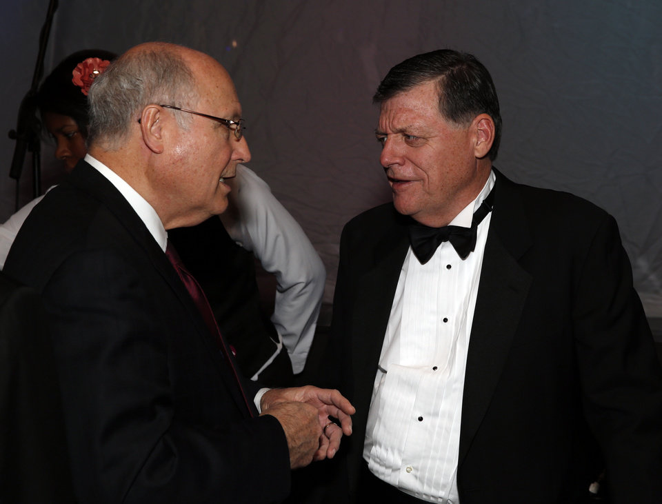 Mark Snyder and Rep. Tom Cole speak as they atend the Oklahoma Speaker's Ball at the Embassy Suites Hotel on Friday, Feb. 1, 2013 in Norman, Okla.  Photo by Steve Sisney, The Oklahoman