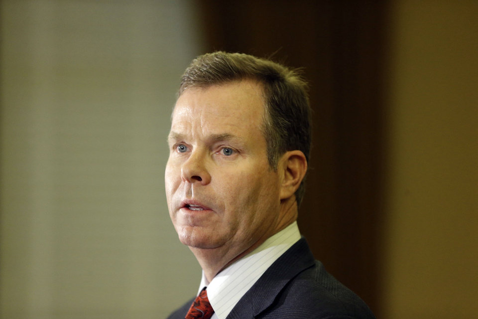 Photo - Utah Attorney General John Swallow speaks during a news conference Thursday, Nov. 21, 2013, in Salt Lake City. Swallow announced Thursday that he is stepping down amid multiple investigations of bribery and misconduct that have hounded him ever since he took office at the beginning of the year. Swallow discussed his resignation as he vigorously denied breaking any laws and said the toll of the investigations had become too much for him and his family.