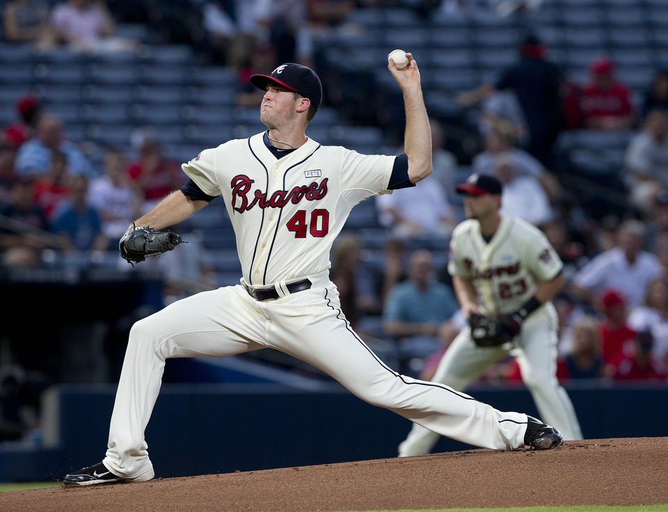 Photo - Atlanta Braves starting pitcher Alex Wood works in the first inning of a baseball game against the Washington Nationals  Sunday, Aug. 10, 2014 in Atlanta. (AP Photo/John Bazemore)