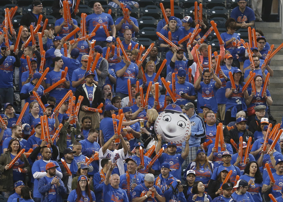 Photo - New York Mets fans react during the first inning of a baseball game against their crosstown rivals, the New York Yankees, during a Subway Series baseball game in New York, Wednesday, May 14, 2014. (AP Photo)