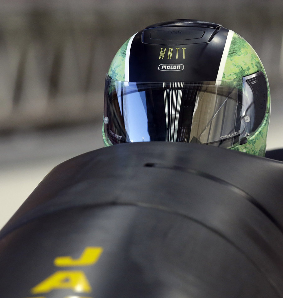 Photo - The JAM-1, from Jamaica and piloted by Winston Watts, starts their training run for the two-man bobsled at the 2014 Winter Olympics, Thursday, Feb. 6, 2014, in Krasnaya Polyana, Russia.  (AP Photo/Dita Alangkara)