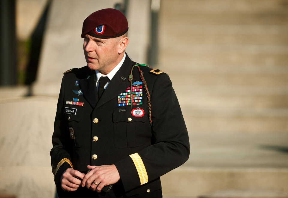 Photo - Army Brig. Gen. Jeffrey A. Sinclair leaves a Fort Bragg, N.C., courthouse Tuesday, Jan. 22, 2013, after he deferred entering a plea at his arraignment on charges of fraud, forcible sodomy, coercion and inappropriate relationships. Sinclair, who served five combat tours, is headed to trial following a spate of highly publicized military sex scandals involving high-ranking officers that has triggered a review of ethics training across the service branches.  (AP Photo/The Fayetteville Observer, Andrew Craft)