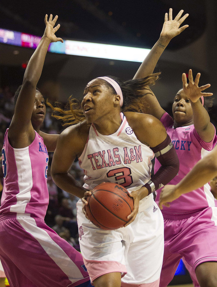 Photo - Texas A&M center Kelsey Bone (3) drives to the basket against Kentucky forward Samarie Walker, left, and DeNesha Stallworth during the first half of an NCAA college basketball game, Monday, Feb. 18, 2013, in College Station, Texas. (AP Photo/Patric Schneider)
