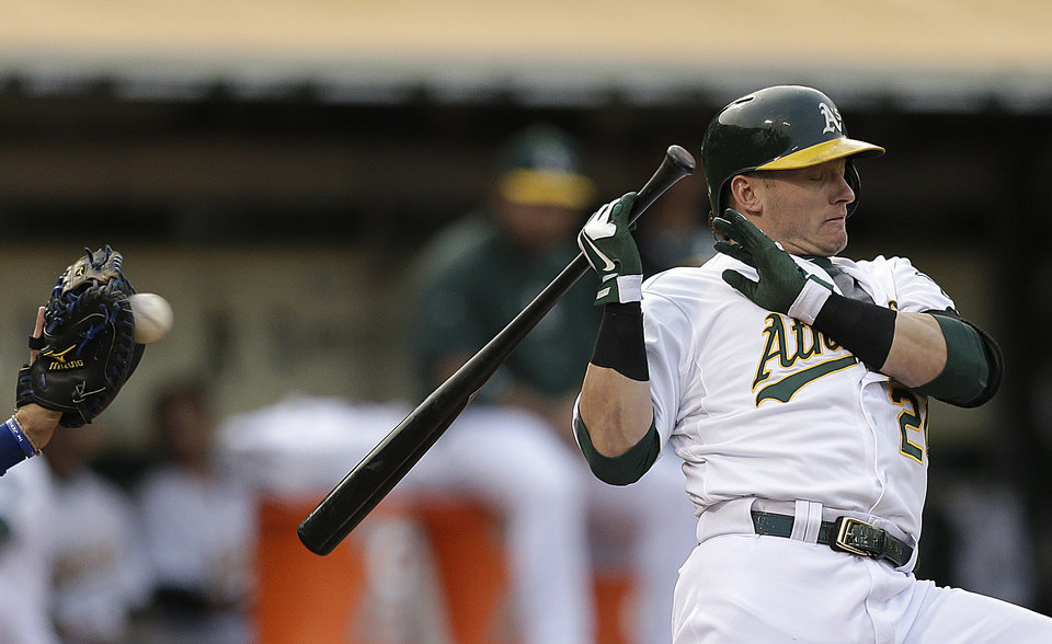 Photo - Oakland Athletics' Josh Donaldson backs away from a pitch thrown by Toronto Blue Jays' Esmil Rogers in the first inning of a baseball game Monday, July 29, 2013, in Oakland, Calif. (AP Photo/Ben Margot)
