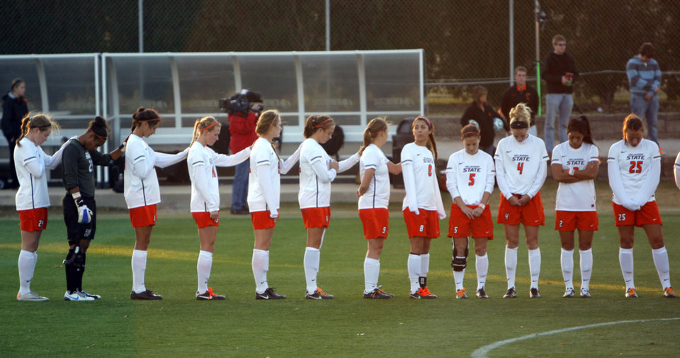 The Oklahoma State Women's soccer team takes a moment of silence during the NCAA soccer game between Oklahoma State University and Illinois Stillwater, Okla.,  Friday, Nov. 18, 2011.  Photo by Sarah Phipps, The Oklahoman