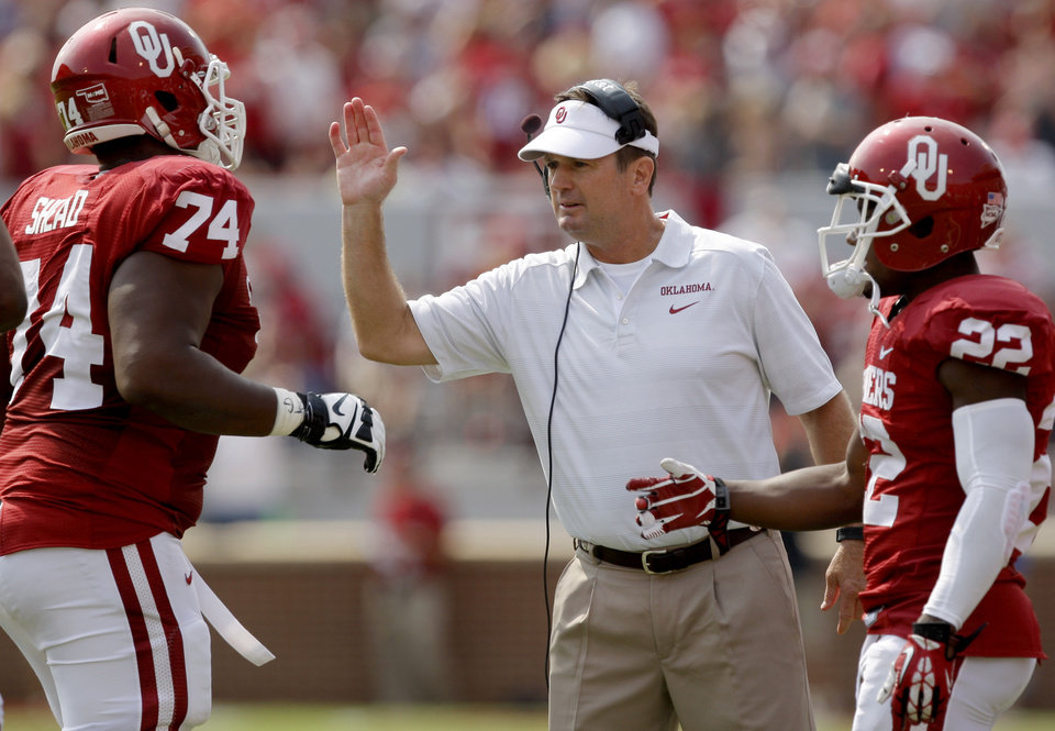 Photo - Oklahoma coach Bob Stoops celebrates after a touchdown during a college football game between the University of Oklahoma Sooners (OU) and the Tulsa Golden Hurricane at Gaylord Family-Oklahoma Memorial Stadium in Norman, Okla., on Saturday, Sept. 14, 2013. Oklahoma won 51-20. Photo by Bryan Terry, The Oklahoman
