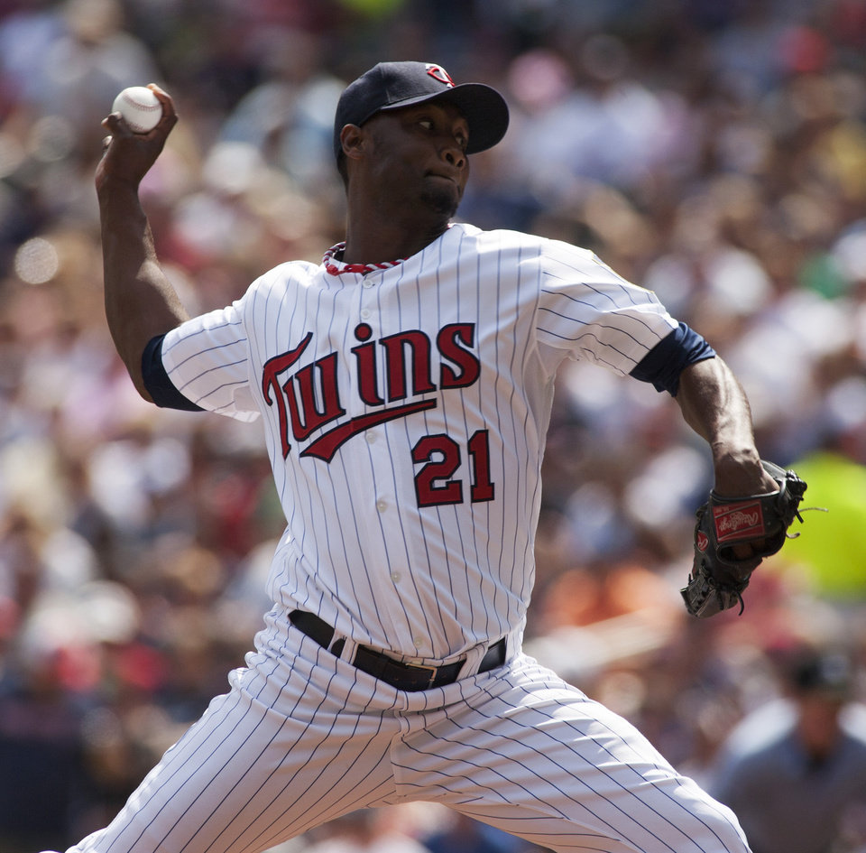 Photo - Minnesota Twins starting pitcher Samuel Deduno (21) delivers against the Chicago White Sox during the first inning of a baseball game on Sunday, Aug. 18, 2013, in Minneapolis. (AP Photo/Paul Battaglia)