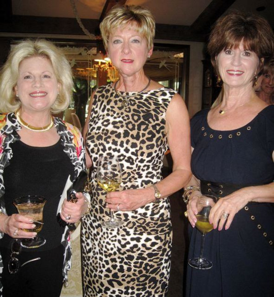 Debby Dudman, Jane Thompson and Barbara Brou enjoy the 60th birthday party honoring Jane. Hostesses were Sherry Beasley, Judy Keeton, Judy Love, Beverly Funke, Lana Lopez and Lou Morris in the Love home. (Photo by Helen Ford Wallace).