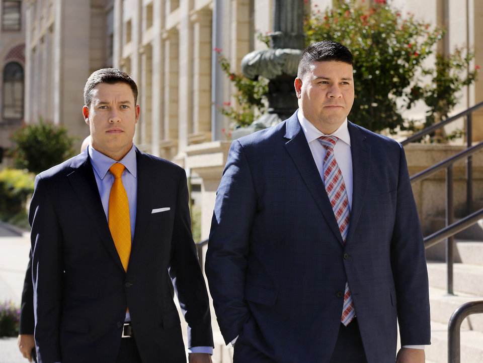 Photo - Former state Sen. Ralph Shortey, right,  is accompanied by his attorney, Ed Blau, as they leave the Federal Courthouse in downtown Oklahoma City Wednesday afternoon, Sep. 6, 2017.  Shortey is now facing a more serious federal indictment over his rendezvous in March with a boy at a Moore hotel. A federal grand jury has returned an indictment Tuesday charging him with child sex trafficking and child pornography offenses.  Shortey, R-Oklahoma City, pleaded not guilty at his first court appearance on Wednesday.  Photo by Jim Beckel, The Oklahoman