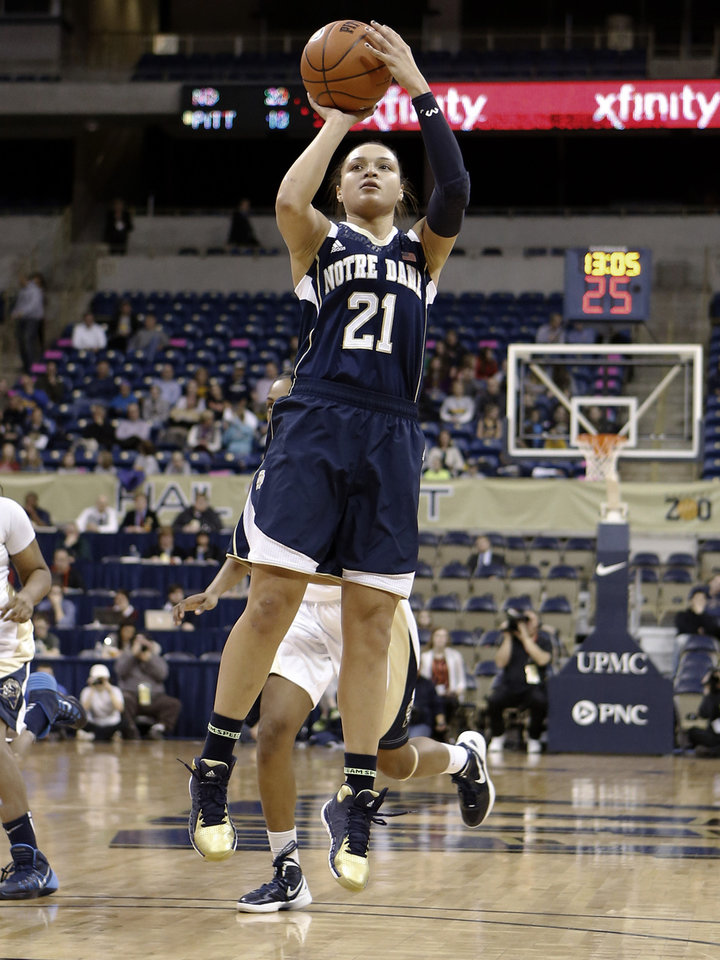 Photo - Notre Dame's Kayla McBride (21) shoots against Pittsburgh during the first half of an NCAA college basketball game Thursday, Jan. 16, 2014, in Pittsburgh. (AP Photo/Keith Srakocic)