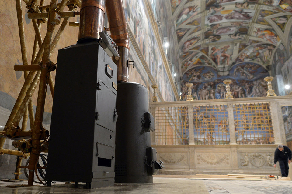 This photo provide by the Vatican newspaper L'Osservatore Romano shows the stoves where the ballots will be burned during the conclave, inside the Sistine Chapel, at the Vatican, Friday, March 8, 2013.  Cardinals have set Tuesday March 12 as the start date for the conclave to elect the next pope, signaling that they were wrapping up a week of discussions about the problems of the church and who best among them might lead it. The conclave date was set on Friday afternoon during a vote by the College of Cardinals. Tuesday will begin with a Mass in the morning in St. Peter's Basilica, followed by the first balloting in the Sistine Chapel in the afternoon. (AP Photo/L'Osservatore Romano, ho)  (