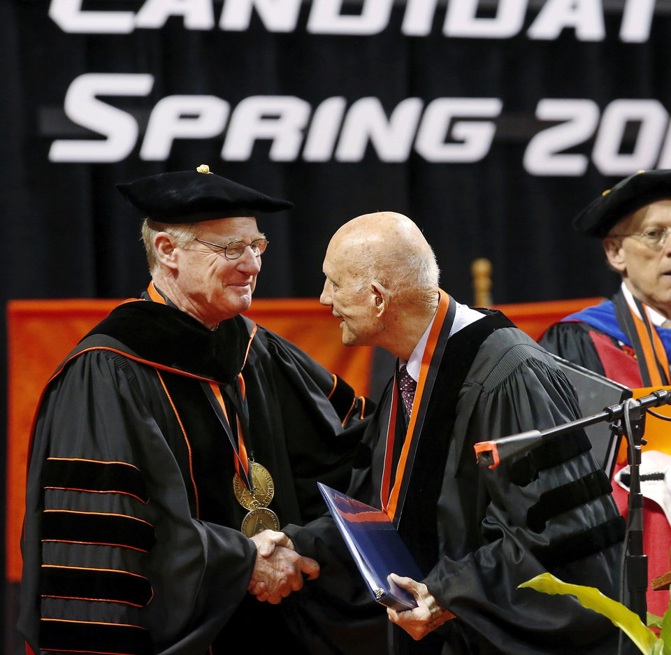 OSU President Burns Hargis, left, expresses his appreciation to astronaut Lt. Gen. , USAF (Ret.) Thomas P. Stafford, after he delivered remarks to the graduates. During an afternoon ceremony, Hargis presented an honorary degree to Stafford on behalf of Oklahoma State University. Undergraduates at OSU participated in the school's 127th commencement ceremony the weekend of Friday, May 3 and Saturday, May 4, 2013 inside Gallagher-Iba Arena on the university's campus.These photos were taken at the Saturday morning ceremony when students from the College of Agricultural Sciences and Natural Resources, and the Spears School of Business were conferred with degrees.   Photo  by Jim Beckel, The Oklahoman.