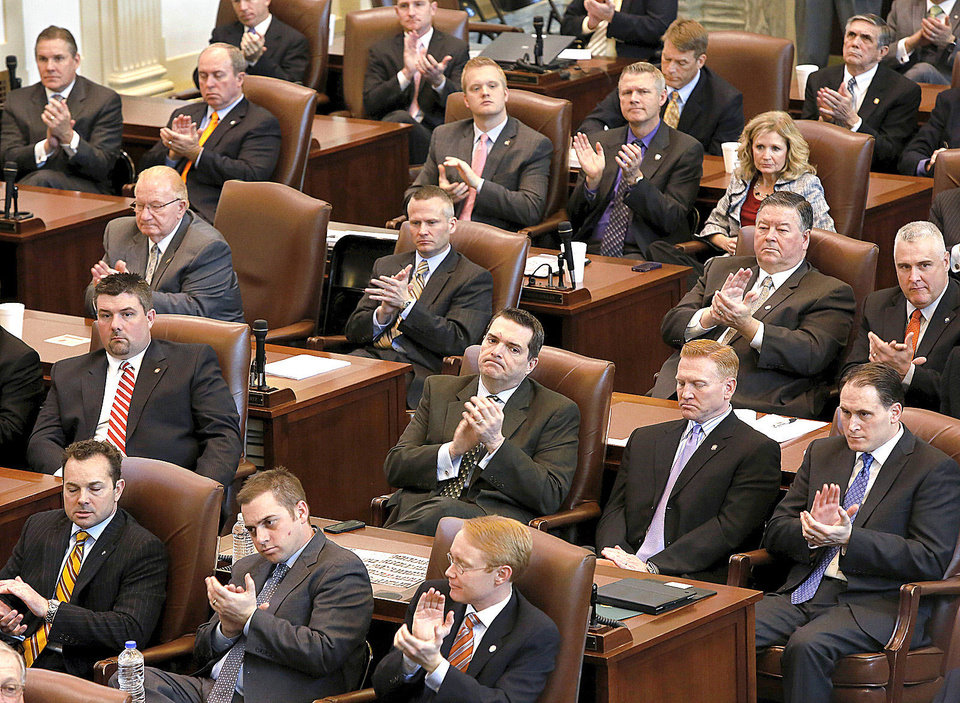 Representatives and senators applaud Monday during Gov. Mary Fallin�s State of the State address in the House of Representatives chamber. Photo by Jim Beckel, The Oklahoman