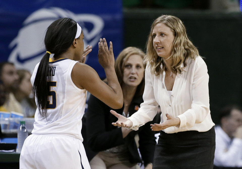 Photo - California's Brittany Boyd (15) celebrates with coach Lindsay Gottlieb late in the second half of a first-round game in the NCAA women's college basketball tournament against Fordham, Saturday, March 22, 2014, in Waco, Texas. California won 64-63. (AP Photo/Tony Gutierrez)