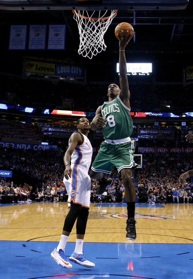 Photo - Boston's Jeff Green (8) shoots a lay up as Oklahoma City's Kevin Durant (35) looks on during the NBA game between the Oklahoma City Thunder and the Boston Celtics at the Chesapeake Energy Arena., Sunday, Jan. 5, 2014. Photo by Sarah Phipps, The Oklahoman