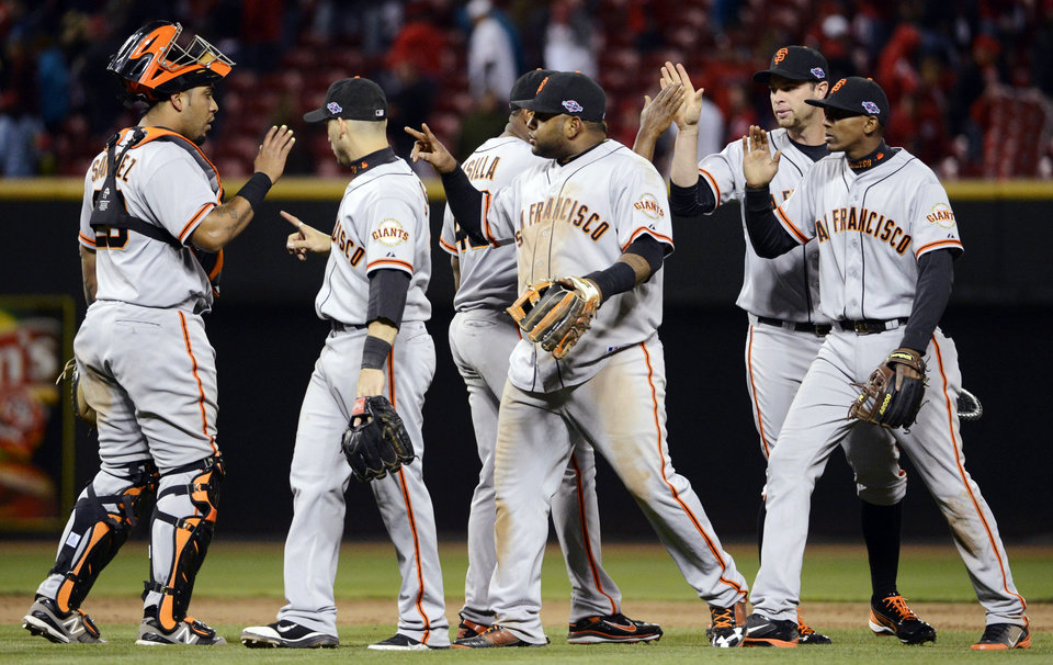 Photo -   San Francisco Giants players celebrate after defeating the Cincinnati Reds 8-3 in Game 4 of the National League division baseball series, Wednesday, Oct. 10, 2012, in Cincinnati. (AP Photo/Michael Keating)