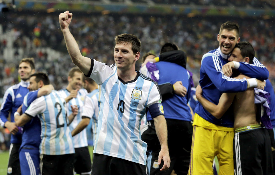 Photo - Argentina's Lionel Messi punches the air after Argentina defeated the Netherlands 4-2 in a penalty shootout after a 0-0 tie after extra time to advance to the finals during the World Cup semifinal soccer match between the Netherlands and Argentina at the Itaquerao Stadium in Sao Paulo Brazil, Wednesday, July 9, 2014. (AP Photo/Victor R. Caivano)