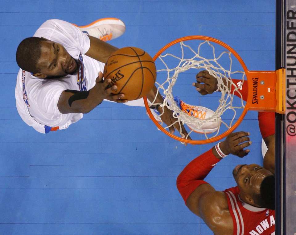 Photo - Oklahoma City's Kevin Durant (35) goes to the basket as Houston's Dwight Howard (12) watches during an NBA basketball game between the Oklahoma City Thunder and the Houston Rockets at Chesapeake Energy Arena in Oklahoma City, Tuesday, March 22, 2016. Photo by Bryan Terry, The Oklahoman