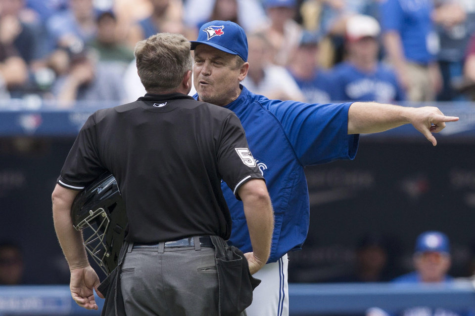 Photo - Toronto Blue Jays manager John Gibbons argues with home plate umpire Greg Gibson during the eighth inning of a baseball game, Wednesday, July 2, 2014 in Toronto. (AP Photo/The Canadian Press, Chris Young)