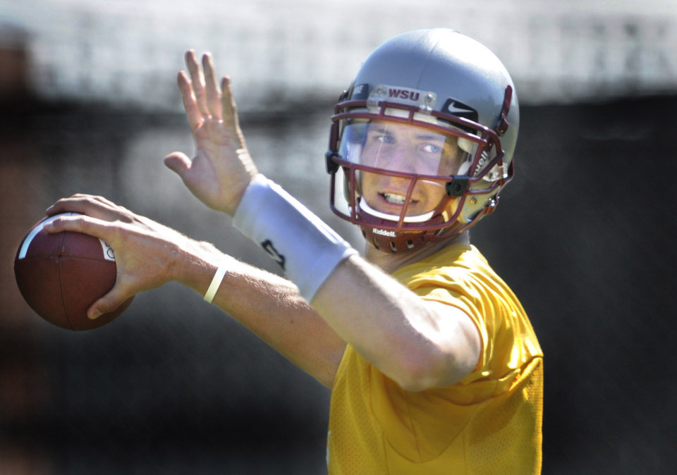 Photo - COLLEGE FOOTBALL: Washington State University's quarterback Gary Rogers throws during drills at the first day of fall practice on Aug.  5, 2008.  (AP Photo/The Spokesman-Review, Christopher Anderson)  ** NO SALES, COEUR D ALENE OUT, TV OUT, MAGS OUT **  ORG XMIT: WASPO101